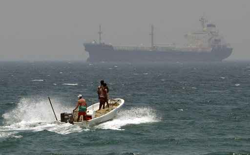 Iran vows to close key strait if US cuts off oil exports