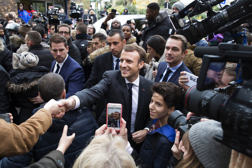 Macron takes Europe's center stage while Merkel falters
