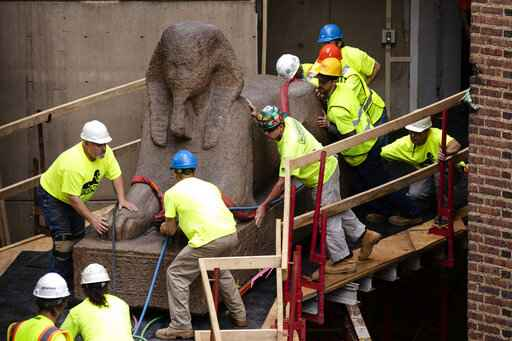 Huge sphinx makes crawling journey to new spot in museum