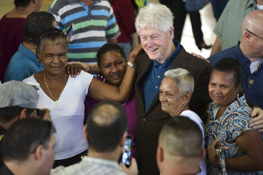 Bill Clinton visits Puerto Rico, distributes relief supplies
