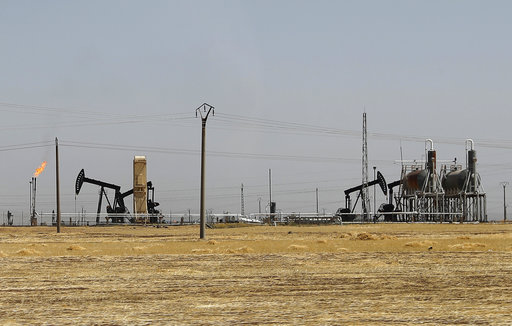 The Latest: IS oil production is greatly reduced since 2014