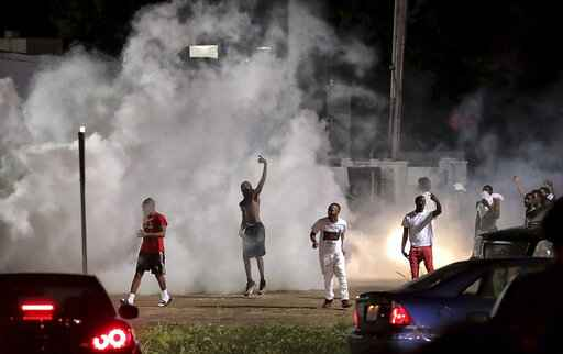 The Latest: Dozens gather peacefully after Memphis shooting