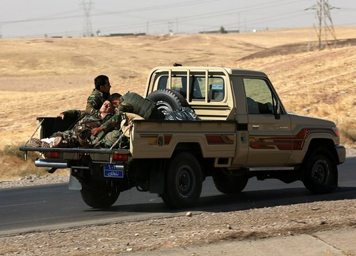 Iraqi forces seize disputed town after clashes with Kurds