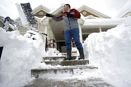 Northeast tries to dig out, power up after latest storm
