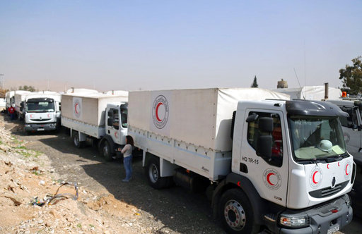 Syria aid convoy on hold, top UN official appeals for calm