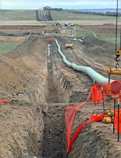 FILE - In this October 2016 file photo, construction continues on the Dakota Access pipeline. A hearing was scheduled for Friday, April 9, 2021, to determine whether the Dakota Access oil pipeline should be allowed to continue operating without a key permit while the U.S. Army Corps of Engineers conducts an environmental review on the project.  (Tom Stromme/The Bismarck Tribune via AP, File)