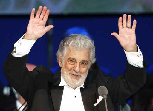 FILE- In this Aug. 28, 2019, file photo, opera singer Placido Domingo performs during a concert in Szeged, Hungary. Domingo will make his first public appearance since recovering from coronavirus to accept a lifetime achievement award on Aug. 6 in Salzburg, Austria. (AP Photo/Laszlo Balogh, File)