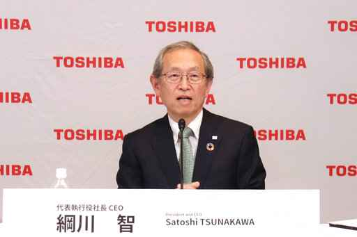 In this image provided by Toshiba Corporation,  new Toshiba President Satoshi Tsunakawa speaks during an online press conference in Tokyo, Wednesday, April 14, 2021.  Nobuaki Kurumatani, the president of Toshiba Corp. stepped down Wednesday, a week after the Japanese technology and manufacturing giant said it was studying an acquisition proposal from a global fund where he previously worked. Kurumatani will be replaced by his predecessor, Tsunakawa.�(Toshiba Corporation via AP)