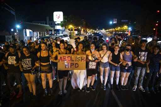 Dozens of community members march, Sunday, June 6, 2021, in Minneapolis, for Winston Boogie Smith Jr., who was fatally shot by members of a U.S. Marshals task force several days earlier. (AP Photo/Christian Monterrosa)