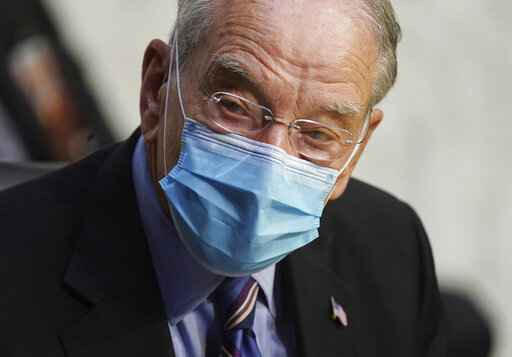 In this Oct. 12, 2020 file photo, Sen. Charles Grassley, R-Iowa, listens during a confirmation hearing for Supreme Court nominee Amy Coney Barrett before the Senate Judiciary Committee, on Capitol Hill in Washington. Grassley, the longest-serving Republican senator, says he is quarantining after being exposed to the coronavirus. Grassley is 87. He did not say how he was exposed. (Kevin Dietsch/Pool via AP)