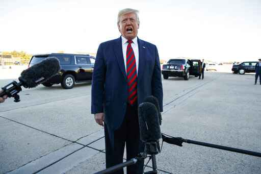President Donald Trump talks to reporters before boarding Air Force One for a trip to Chicago to attend the International Association of Chiefs of Police Annual Conference and Exposition, Monday, Oct. 28, 2019, in Andrews Air Force Base, Md. (AP Photo/Evan Vucci)