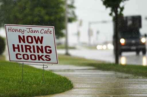 A hiring sign is shown in Downers Grove, Ill., Thursday, June 24, 2021. The number of Americans collecting unemployment benefits slid last week, another sign that the job market continues to recover rapidly from the coronavirus recession. Jobless claims dropped by 24,000 to 400,000 last week, the Labor Department reported Thursday, July 29, 2021. (AP Photo/Nam Y. Huh, File)