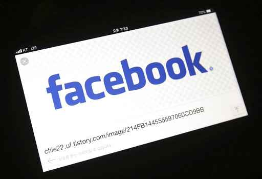 FILE - In this Wednesday, March 21, 2018 file photo, the Facebook logo is seen on a smartphone in Ilsan, South Korea. Facebook has started testing a tool that lets users move their images more easily to other online services, as it faces pressure from regulators to loosen its grip on data. The social network said Monday, Dec. 2, 2019 the new tool will allow people to transfer their photos and videos to other platforms, starting with Google Photos. (AP Photo/Ahn Young-joon)