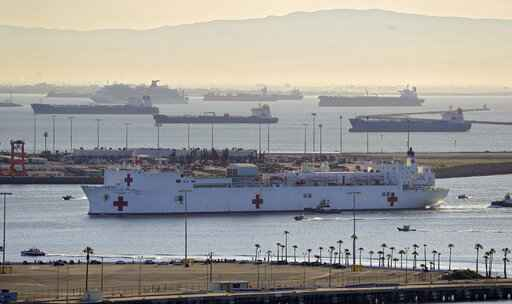 The USNS Mercy enters the Port of Los Angeles, Friday, March 27, 2020, in Los Angeles. The The 1,000-bed Navy hospital ship is expected to help take the load off Los Angeles area hospitals as they treat coronavirus patients. The new coronavirus causes mild or moderate symptoms for most people, but for some, especially older adults and people with existing health problems, it can cause more severe illness or death. (AP Photo/Mark J. Terrill)