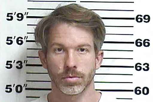 In this Oct. 12, 2020 booking photo provided by the Appanoose County Sherrif's Office, in Centerville, Iowa, shows Ryan James McCord. McCord, a former criminal prosecutor in Des Moines County, is charged with harassment for allegedly threatening to pursue meritless criminal charges against his ex-fiancee, a doctor from Iran, that he warned could lead to her deportation. (Appanoose County Sherrif's Office via AP)