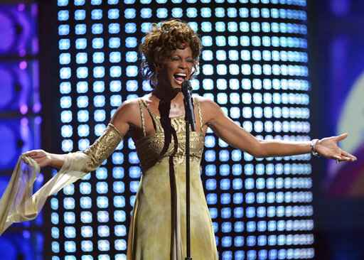 FILE - In this Sept. 15, 2004 file photo, recording artist Whitney Houston performs at the 2004 World Music Awards at the Thomas and Mack Arena in Las Vegas. Houston is about to appear on the concert stage again. Eight years after her death, five years after the show was conceived and a year after production began, a holographic Houston will embark on a European tour starting Feb. 25, with U.S. dates expected to follow. The singer's sister-in-law and former manager Pat Houston says it's the right time for a revival, and says it's a show Whitney Houston would've wanted. The concerts will feature a projected Houston performing most of her biggest hits, including
