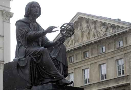 A statue of Poland's 16th century astronomer Nicolaus Copernicus in front of Poland's Academy of Sciences, a leading research institute, in Warsaw, Poland, on Wednesday, April 7, 2021. The academy's head fears that the right-wing government wants to replaced it with a new, government-controlled body that it is working on and which is to be named the National Copernicus Program.(AP Photo/Czarek Sokolowski)
