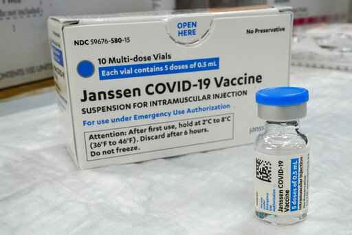 FILE - In this Thursday, April 8, 2021 file photo, the Johnson & Johnson COVID-19 vaccine sits on a table at a pop up vaccinations site the Albanian Islamic Cultural Center,  in the Staten Island borough of New York. The U.S. is recommending a