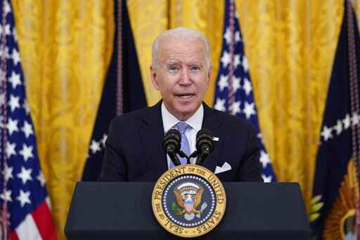 President Joe Biden announces from the East Room of the White House in Washington, Thursday, July 29, 2021, that millions of federal workers must show proof they've received a coronavirus vaccine or submit to regular testing and stringent social distancing, masking and travel restrictions in an order to combat the spread of the coronavirus. (AP Photo/Susan Walsh)