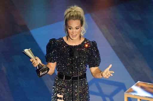 Carrie Underwood accepts the entertainer of the year award in a tie with Thomas Rhett during the 55th annual Academy of Country Music Awards at the Grand Ole Opry House on Wednesday, Sept. 16, 2020, in Nashville, Tenn. (AP Photo/Mark Humphrey)