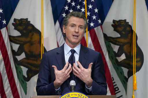 FILE - In this Jan. 8, 2021, file photo, California Gov. Gavin Newsom outlines his 2021-2022 state budget proposal during a news conference in Sacramento, Calif. California Democratic leaders are being criticized after attempting to link the insurrection at the U.S. Capitol with efforts to recall Newsom. State Democratic Party Chair Rusty Hicks led a group of Democratic officials who described the effort to remove Newsom as a