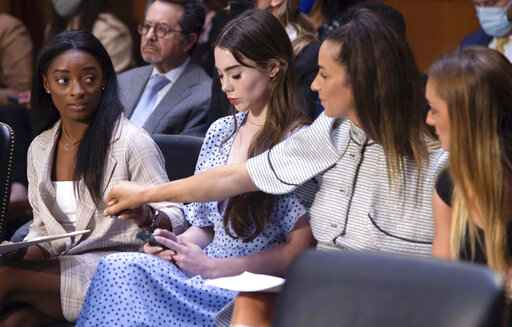 United States gymnasts from left, Simone Biles, McKayla Maroney, Aly Raisman and Maggie Nichols, arrive to testify during a Senate Judiciary hearing about the Inspector General's report on the FBI's handling of the Larry Nassar investigation on Capitol Hill, Wednesday, Sept. 15, 2021, in Washington. Nassar was charged in 2016 with federal child pornography offenses and sexual abuse charges in Michigan. He is now serving decades in prison after hundreds of girls and women said he sexually abused them under the guise of medical treatment when he worked for Michigan State and Indiana-based USA Gymnastics, which trains Olympians. (Saul Loeb/Pool via AP)