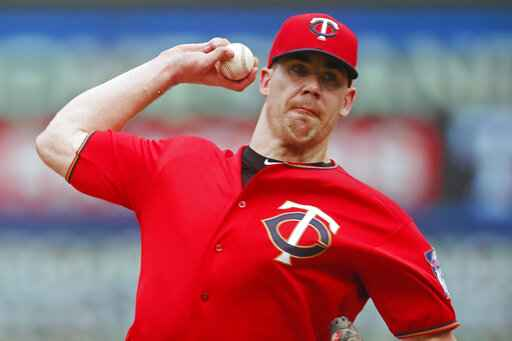 FILE - In this June 27, 2019, file photo, Minnesota Twins relief pitcher Trevor May throws against the Tampa Bay Rays during a baseball game in Minneapolis. Trevor May has been preparing for this. Not precisely for a global pandemic that would bring sports - and so much else - to an unprecedented standstill. But a break in the baseball schedule? That's something the Minnesota Twins reliever - and pro video game streamer - thought might happen eventually. (AP Photo/Jim Mone, File)