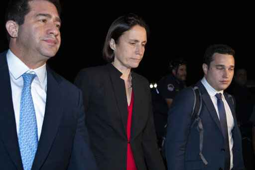 Former White House advisor on Russia, Fiona Hill, center, leaves Capitol Hill in Washington, Monday, Oct. 14, 2019, after testifying before congressional lawmakers as part of the House impeachment inquiry into President Donald Trump. (AP Photo/Manuel Balce Ceneta)