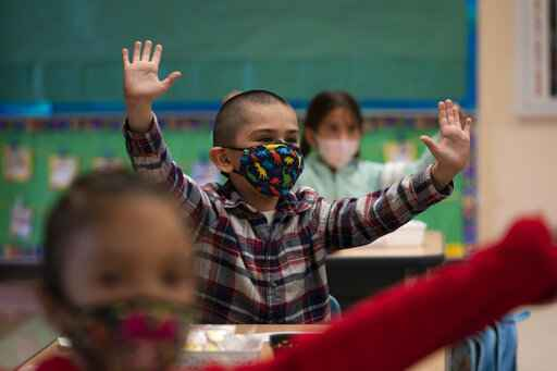 Kindergarten students participate in a classroom activity on the first day of in-person learning at Maurice Sendak Elementary School in Los Angeles, Tuesday, April 13, 2021. More than a year after the pandemic forced all of California's schools to close classroom doors, some of the state's largest school districts are slowly beginning to reopen this week for in-person instruction. (AP Photo/Jae C. Hong)