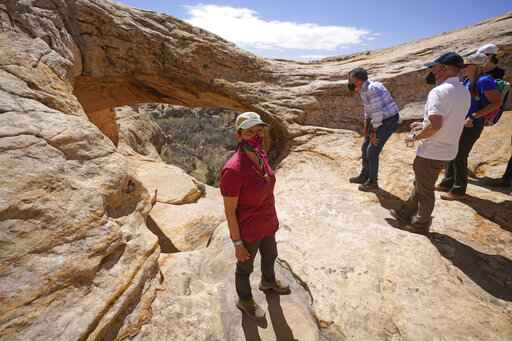 U.S. Interior Secretary Deb Haaland tours near ancient dwellings along the Butler Wash trail during a visit to Bears Ears National Monument Thursday, April 8, 2021, near Blanding, Utah. (AP Photo/Rick Bowmer, Pool)