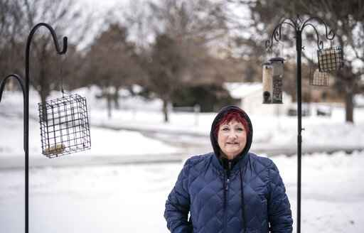 Barbara Gusse poses for a photo at her home on Sunday Feb. 7, 2021, in Brooklyn Center, Minn. Gusse spotted a stolen SUV that triggered an Amber Alert on Saturday afternoon, Feb. 6 leading police to the abandoned vehicle and the crying toddler inside.  (Jerry Holt/Star Tribune via AP)