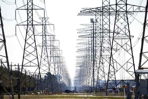 FILE - This Tuesday, Feb. 16, 2021 file photo shows power lines in Houston. The electric grid manager for most of Texas issued an electricity conservation watch Tuesday, April 13, 2021 appealing to customers to conserve electricity despite weather conditions typical for spring. (AP Photo/David J. Phillip)