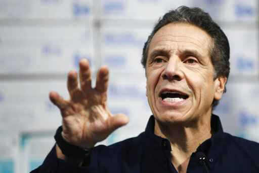 New York Gov. Andrew Cuomo speaks during a news conference against a backdrop of medical supplies at the Jacob Javits Center that will house a temporary hospital in response to the COVID-19 outbreak, Tuesday, March 24, 2020, in New York. Cuomo sounded his most dire warning yet about the coronavirus pandemic, saying the infection rate in New York is accelerating and the state could be as close as two weeks away from a crisis that projects 40,000 people in intensive care. (AP Photo/John Minchillo)