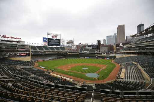 The scoreboard at Target Field explains the postponement of the baseball game between the Minnesota Twins and Boston Red Sox, Monday, April 12, 2021, in Minneapolis. The Twins postponed their game against the Red Sox because of safety concerns following the fatal police shooting of a Black man and the potential for unrest in the area. (AP Photo/Stacy Bengs)