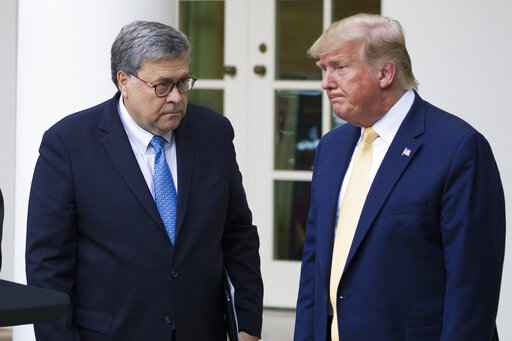 FILE - In this July 11, 2019, file photo, Attorney General William Barr, left, and President Donald Trump turn to leave after speaking in the Rose Garden of the White House, in Washington. Attorney General William Barr took a public swipe Thursday at President Donald Trump, saying that the president's tweets about Justice Department prosecutors and cases