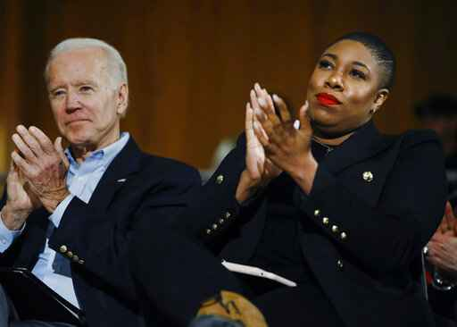FILE - In this Jan. 27, 2020, file photo, Democratic presidential candidate, former Vice President Joe Biden and senior adviser Symone Sanders participate in a campaign event in Iowa City, Iowa. Biden's status as Democratic presidential nominee-in-waiting means the party will choose another man for an office never held by a woman. But he's running with plenty of women behind him, including a yet-to-be-named vice presidential running mate. (AP Photo/Matt Rourke, File)