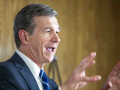 FILE - In this May 27, 2021 file photo, North Carolina Gov. Roy Cooper speaks to the gathered media after his tour of a COVID-19 vaccine clinic at the Pine Hall Brick plant in Madison, N.C.   North Carolina's Senate approved a measure on Thursday, June 10,  to prohibit doctors from performing abortions if a woman is seeking it because of race, sex or a prenatal diagnosis of Down syndrome.  (Woody Marshall/News & Record via AP, File)
