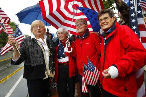 'Freeport flag ladies' wave Stars and Stripes one final time