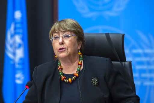FILE - In this Wednesday, Dec. 9, 2020 file photo Michelle Bachelet, UN High Commissioner for Human Rights, speaks during a press conference at the European headquarters of the United Nations in Geneva, Switzerland. The U.N. human rights chief is calling for a moratorium on the use of artificial intelligence technology that poses a serious risk to human rights, including face-scanning systems that track people in public spaces. Michelle Bachelet also says countries should expressly ban AI applications that don't comply with international human rights law. Applications that should be prohibited include government