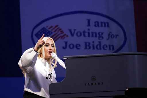 FILE - In this Nov. 2, 2020 file photo, Lady Gaga performs during a drive-in rally for then Democratic presidential candidate former Vice President Joe Biden at Heinz Field in Pittsburgh.  Lady Gaga will sign the national anthem at Joe Biden's presidential inauguration on the West Front of the U.S. Capitol when Biden is sworn in as the nation's 46th president next Wednesday. (AP Photo/Andrew Harnik)