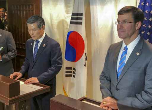 U.S. Defense Secretary Mark Esper, right, and South Korea defense Minister Jeong Kyeong-doo attend a press conference in Bangkok, Thailand, Sunday, Nov. 17, 2019. Esper and his South Korean counterpart announced Sunday that U.S. and South Korea are postponing a joint military air exercise that North Korea has criticized as provocative. (AP Photo/Robert Burns)