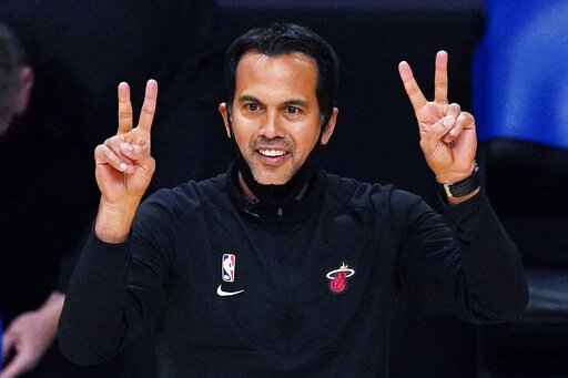 Miami Heat coach Erik Spoelstra gestures to the team during the first half of an NBA basketball game against the Los Angeles Lakers on Saturday, Feb. 20, 2021, in Los Angeles. (AP Photo/Mark J. Terrill)