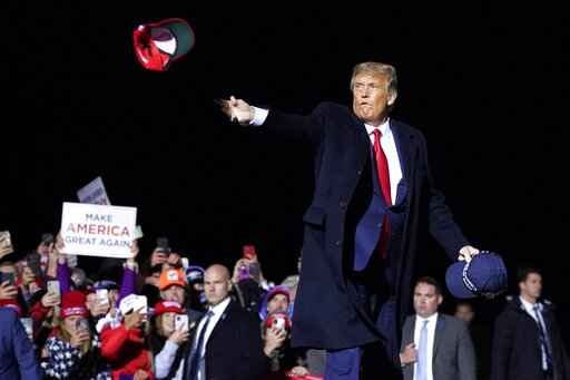 President Donald Trump throws hats into the crowd after speaking at a campaign rally at Duluth International Airport, Wednesday, Sept. 30, 2020, in Duluth, Minn. (AP Photo/Alex Brandon)