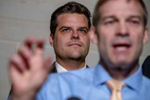 FILE- In this Oct. 8, 2019 photo, Rep. Jim Jordan, R-Ohio, ranking member of the Committee on Oversight Reform, foreground, accompanied by Rep. Matt Gaetz, R-Fla., center, speaks on Capitol Hill in Washington. Gaetz is an unabashed supporter of President Trump, defending him on the impeachment inquiry, the investigation into Russia meddling in U.S. elections and other issues. (AP Photo/Andrew Harnik, File)