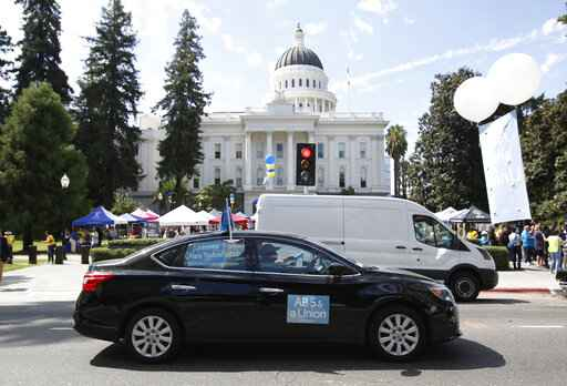 The Latest: Bill passed involving wages at Uber, other firms