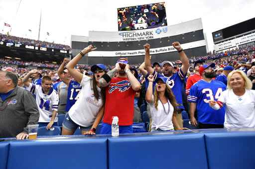 Fans cheer during the second half of an NFL football game between the Buffalo Bills and the Pittsburgh Steelers in Orchard Park, N.Y., Sunday, Sept. 12, 2021. (AP Photo/Joshua Bessex)