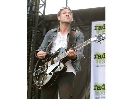 "FILE - This May 3, 2015 file photo shows Mikel Jollett of The Airborne Toxic Event performing in concert during the Radio 104.5 Summer Block Party in Philadelphia. Celadon Books announced Tuesday that Jollett's  memoir, ""Hollywood Park,"" also the title of the band's next album, will come out May 5. (Photo by Owen Sweeney/Invision/AP, File)"