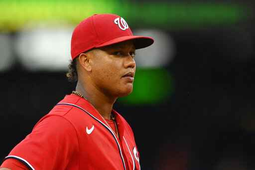 FILE - In this June 19, 2021, file photo, Washington Nationals third baseman Starlin Castro looks on during the second baseball game of a doubleheader against the New York Mets in Washington. Castro was placed on administrative leave Friday, July 16, 2021, by Major League Baseball under its domestic violence, sexual assault and child abuse policy. (AP Photo/Nick Wass, File)
