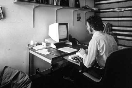 In this 1970s photo provided by Xerox PARC, Larry Tesler uses the Xerox Parc Alto early personal computer system. Tesler, the Silicon Valley pioneer who created the now-ubiquitous computer concepts such as