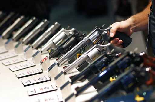 FILE - In this Jan. 19, 2016, file photo, handguns are displayed at the Smith & Wesson booth at the Shooting, Hunting and Outdoor Trade Show in Las Vegas. The Mexican government sued U.S. gun manufacturers and distributors, including some of the biggest names in guns like Smith & Wesson Brands, on Aug. 4, 2021 in U.S. federal court in Boston, arguing that their commercial practices have unleashed tremendous bloodshed in Mexico. (AP Photo/John Locher, File)